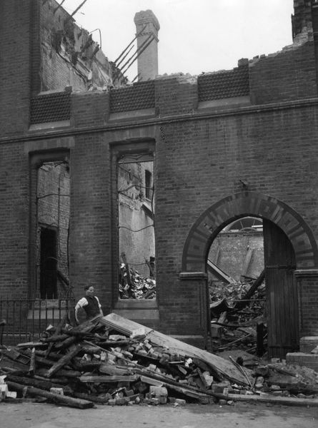 The aftermath of a fire at the Scripture Gift Mission, Naval & Military Bible Society, Eccleston Place, Victoria, London, on 23 April 1956, where there had also been an explosion