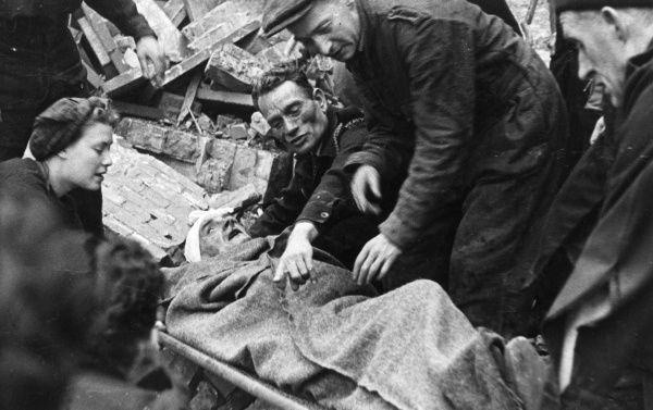 Blitz in London -- rescuing a casualty and putting him on a stretcher. (1 of 3)