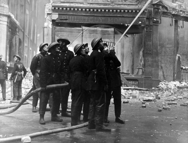Blitz in London -- men at work with hosepipes in Shoe Lane, City of London, during the Second World War