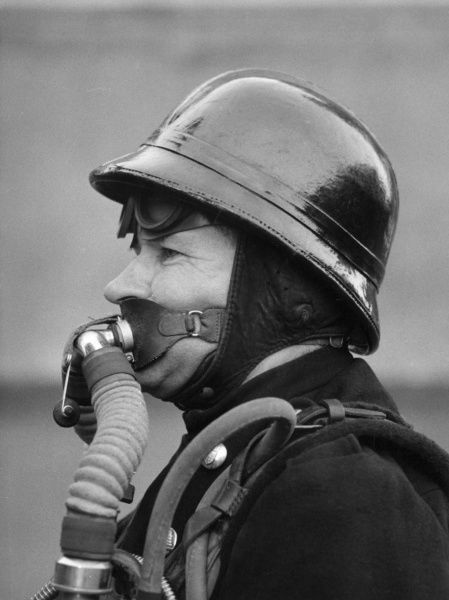 LFB firefighter in a new breathing apparatus helmet (side view), 14 December 1956