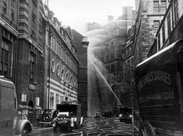 Blitz in London -- LFB tackling a blaze following an incendiary bomb attack on Great Scotland Yard on 13th September 1940, next to the LCC-MFB Scotland Yard Fire Station