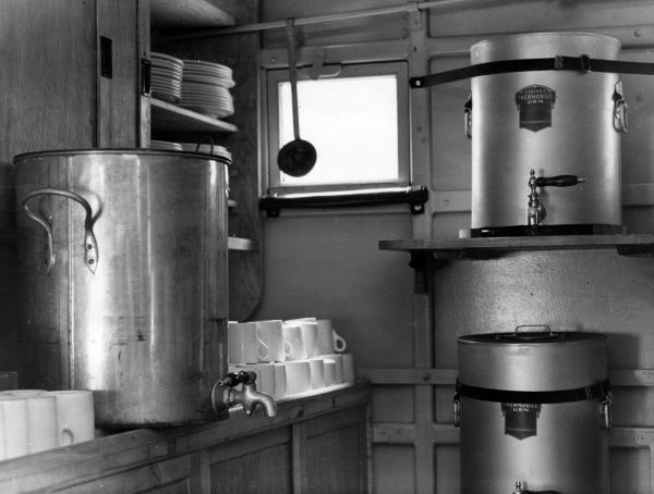 Interior of a mobile kitchen, looking towards the rear, 25 August 1941