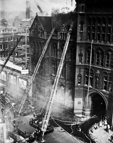 Three turntable ladders are got to work at the fire at the Prudential Assurance Company building in High Holborn WC1, 16 June 1932