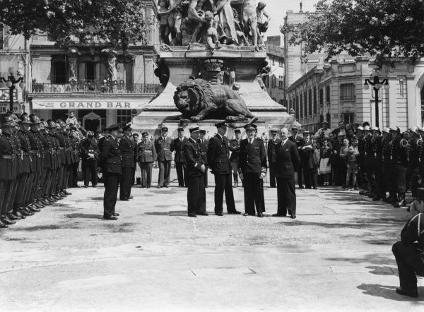 LFB firefighters on a working tour of France and Italy, 1-23 June 1953. Seen here in an outdoor event with their French counterparts