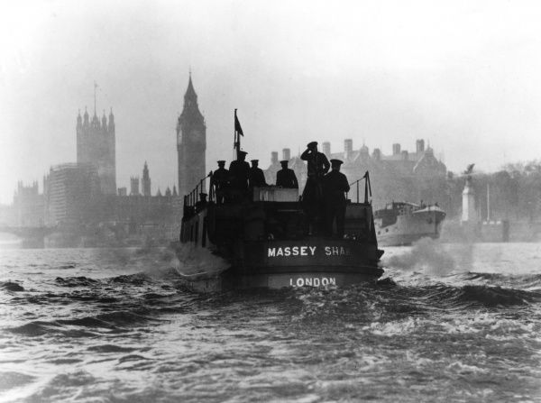 Massey Shaw fireboat on the River Thames with the Houses of Parliament in the background
