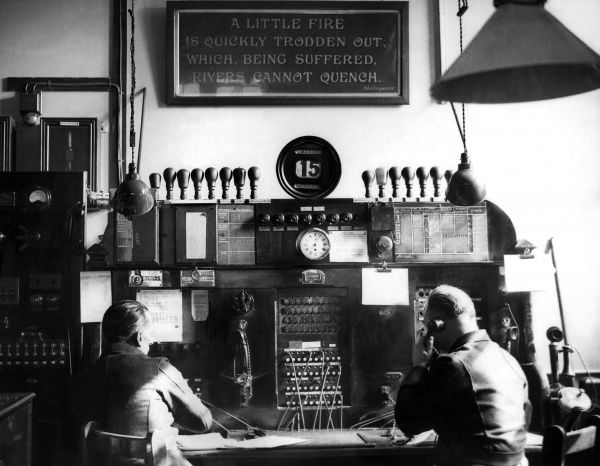 Firefighters working on the watchroom telephone switchboard at Southwark Fire Station