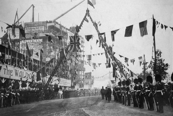 Opening of Kingsway and Aldwych, London, by King Edward VII, on 18 October 1905, with an archway provided by the London Fire Brigade. The building site for the Waldorf Hotel (completed 1908) can be seen on the left
