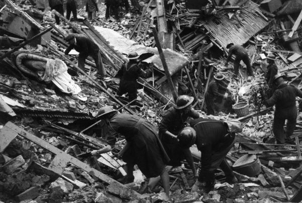 Rescuers picking through the debris after a bombing raid, London, Second World War