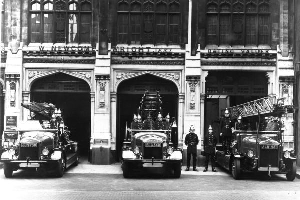 The pump, pump escape and turntable ladder, with their crews, on the forecourt of Bishopsgate fire station, City of London