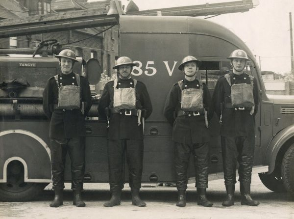 Four AFS (Auxiliary Fire Service) men stationed at Brixton during the Second World War. The man on the left is Jack Hall. The photo is believed to have been taken outside William Penn School, Dulwich