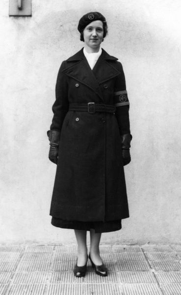 AFS woman in double-breasted greatcoat, beret, white scarf and armband (front view)