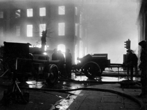Scene in Queen Street, with trailer pumps at work, following a bombing raid and incendiary attack, 11 May 1941