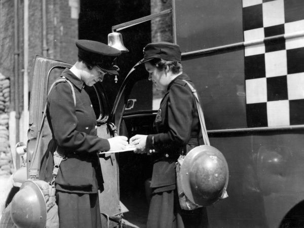 Blitz in London -- two AFS women outside a control unit, 27 June 1941