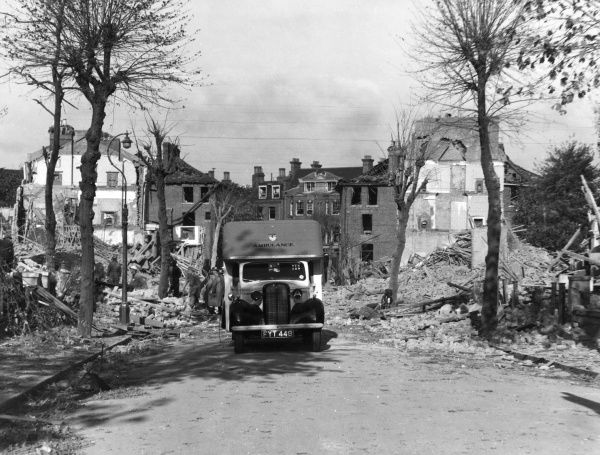 Blitz in London -- an ambulance and rescue workers in the Ladywell area of Lewisham, SE13, where houses were demolished by a parachute bomb, 18 September 1940