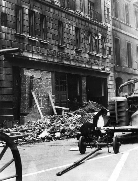 Blitz in London -- Cannon Street fire station in the City damaged by bombing, 16 April 1941. The words 'dangerous wall' have been chalked up
