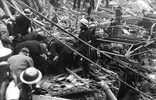 Blitz in London -- rescue personnel extricating a casualty from debris following an air raid