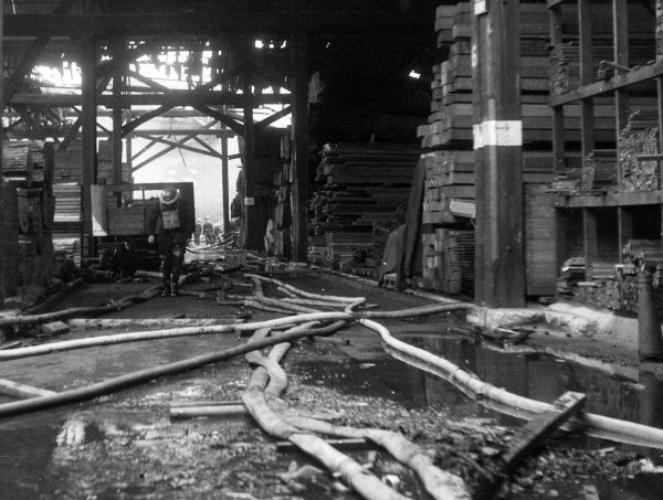 Blitz in London -- firefighters at work with hosepipes, Howards Timber Yard, Poplar, 21 September 1940