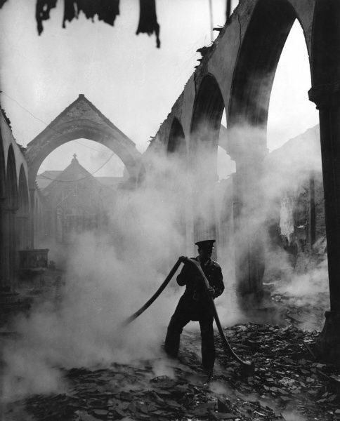 Blitz in Plymouth -- the smouldering remains of St Andrew's Parish Church, bombed and badly damaged in March 1941. The church was restored, and reconsecrated in November 1957