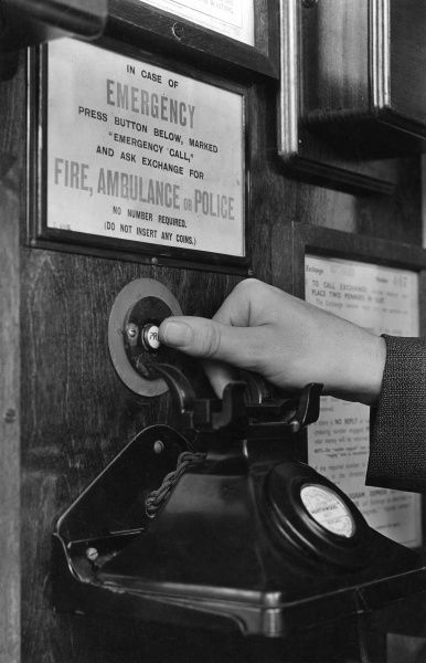 The emergency call button in a public telephone box -- just press the button and ask for Fire, Ambulance or Police. No number or coins required