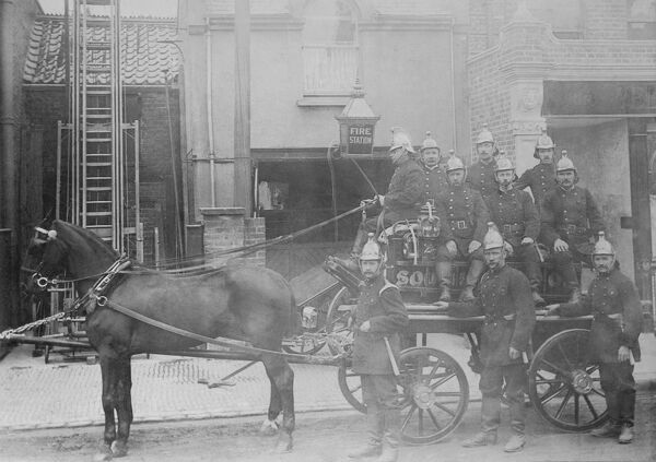 Fire crew and horse drawn pump