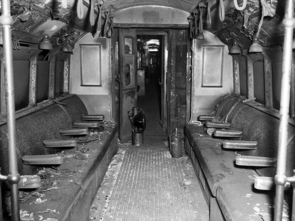 Fire in a London Underground train near Holland Park Station, 28 July 1958. General view of the fire-damaged rear section of the first carriage, with shattered non-splinterable glass in the communicating door and scorched seat covering