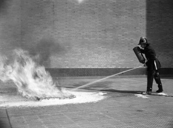 Firefighter training with a foam extinguisher, 18 April 1956