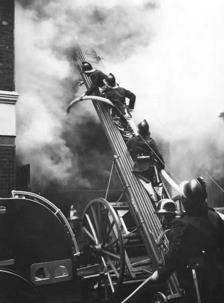 Firefighters in action at a fire in Eagle Street, London WC1, 0738 hrs, 9 June 1955