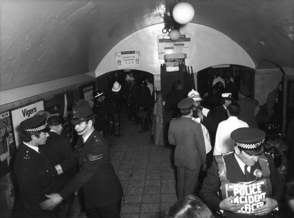 Firefighters and police in the London Underground during an incident on 28 February 1975. An underground train had failed to stop at Moorgate station and had crashed into the wall at the end of the tunnel, killing 43 people