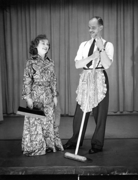 Man and woman in costume, performing a comic sketch