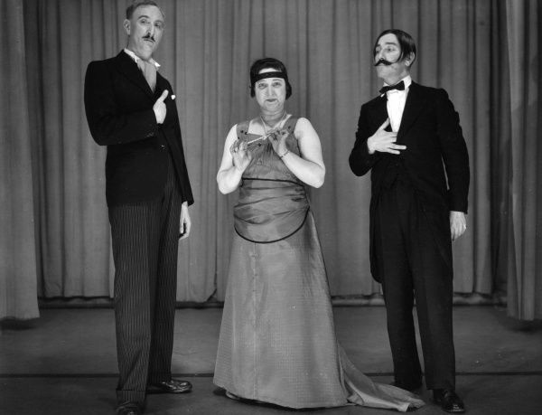 Two men and a woman performing in a comic sketch