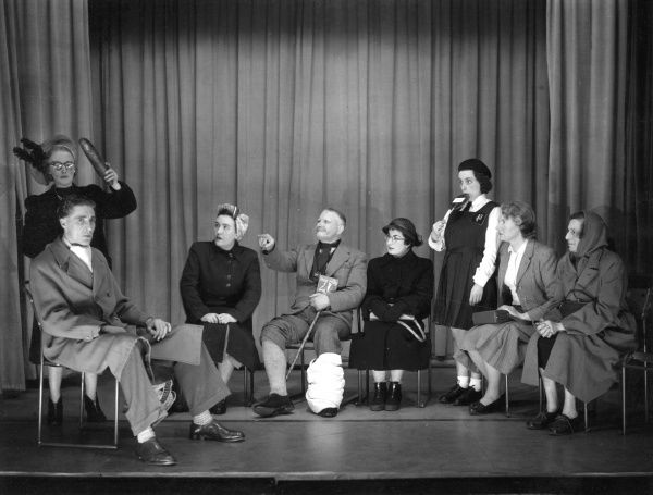 Men and women performing in a comic sketch