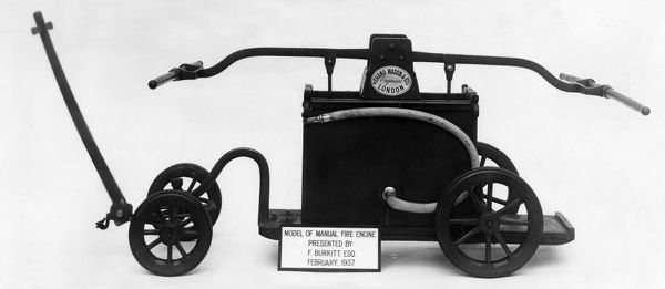 Model of an old manual Shand Mason fire engine, presented by F Burkitt in February 1937