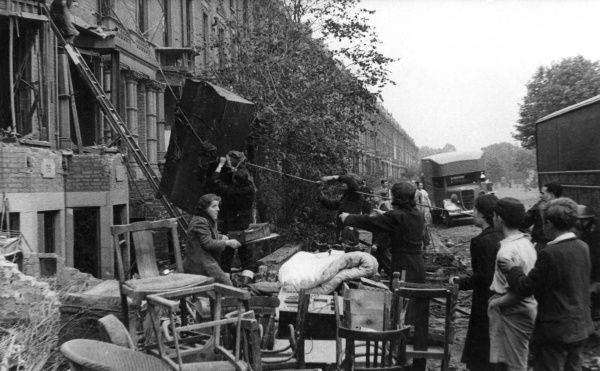 Firefighters helping residents to salvage furniture from their damaged homes, London, 2 July 1944, Second World War