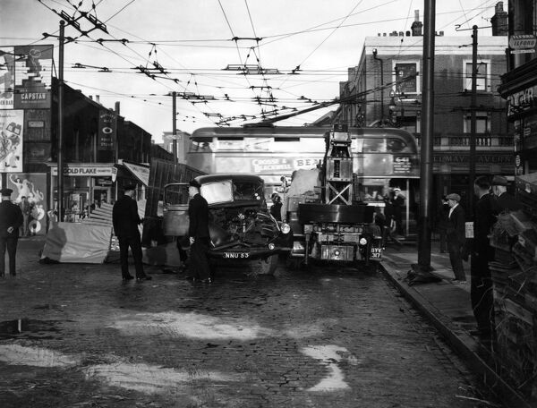 Scene of an accident in an Islington street, North London, with a trolley bus passing by