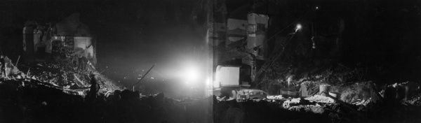 A panoramic night scene in Shardeloes Road, New Cross, during the Second World War, showing the aftermath of an air raid, 3 November 1944