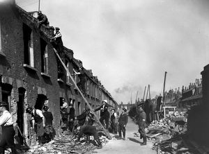 Blitz in London -- rescue workers in bombed street, WW2