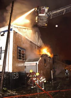 Firefighters attending fire at commercial premises