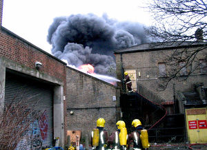 Firefighters at the scene of a warehouse fire, SE London