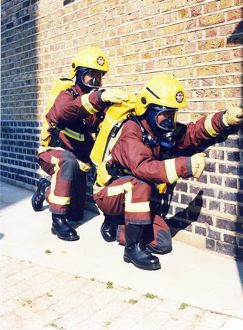 Firefighters in training with breathing apparatus