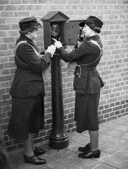 Women of the Auxiliary Fire Service using a telephone, WW2