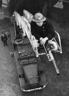 Blitz in London -- AFS firefighter on ladder, WW2