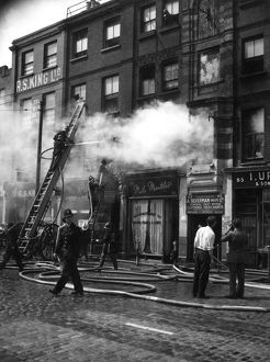 Firefighters in action in Commercial Road, East London
