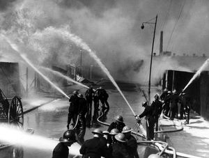London firefighters at work with hosepipes